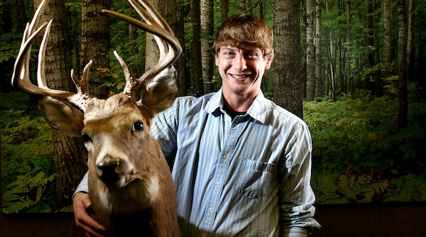 Adam Murkowski, the new DNR big game program manager, has had a passion for deer hunting and deer biology since his youth. Here he posed with a buck r