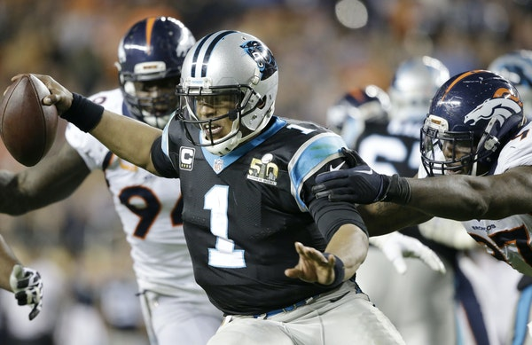 Carolina Panthers' Cam Newton (1) scrambles away from Denver Broncos' DeMarcus Ware (94) and Malik Jackson (97) during the second half of the NFL