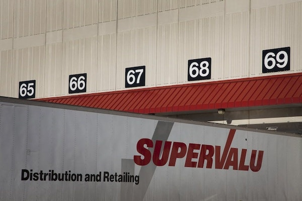 The Supervalu Inc. logo is displayed on a truck at a distribution center in Hopkins.