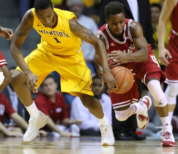 The University of Minnesota's Depree McBrayer (1) battles for a loose ball with the University of Indiana's Kevin Yog Ferrell (11) during the second h