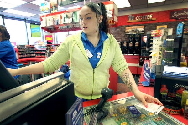 Super America cashier Belinda Contreras sold many Powerball tickets to customers on Jan. 8, 2016, in Minneapolis. The store recently sold a winning ti