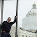 "John Kaul, posing in the new Minnesota Senate Building, says: ""I'm an artist locked in the body of a lobbyist."""