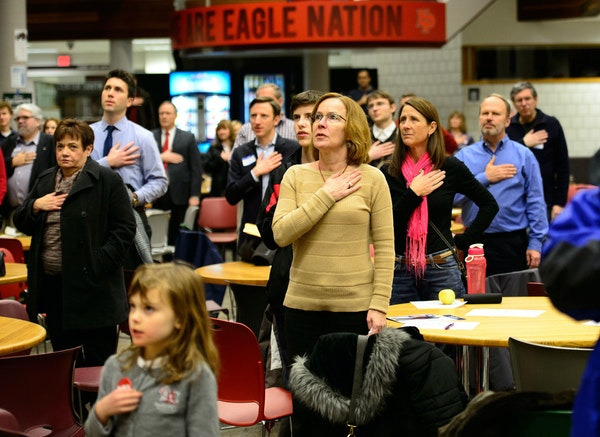 Republicans said the pledge of allegiance before the start of the caucus at Eden Prairie High School on Feb. 4, 2014.