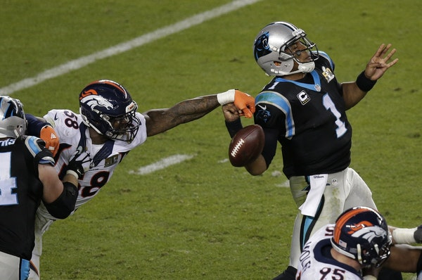 The Broncos' Von Miller (58) stripped the ball from Panthers quarterback Cam Newton during the second half of Denver's 24-10 victory in Super Bowl 50