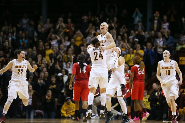 Carlie Wagner (33) and Mikayla Bailey (24) celebrate their overtime win against Ohio State.