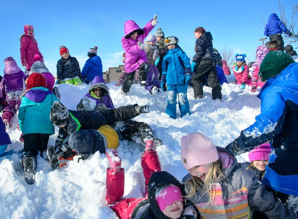 Students at Paideia Academy reveled in the mountains of plowed snow at their charter school in Apple Valley. Sledding hills and ski trails were lively