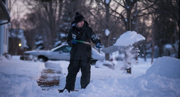"""Justin Lang shoveled a driveway. """"I just want people to be nice to one another,"""" he said."""