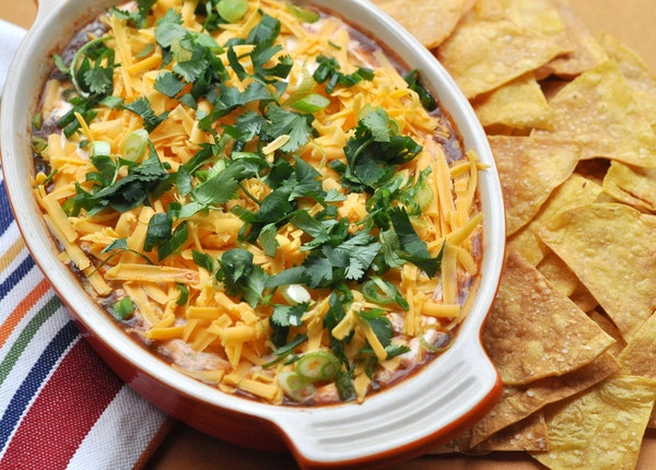 Mexican Layered Dip With Baked Tortilla Chips has plenty of flavor without all the guilt.