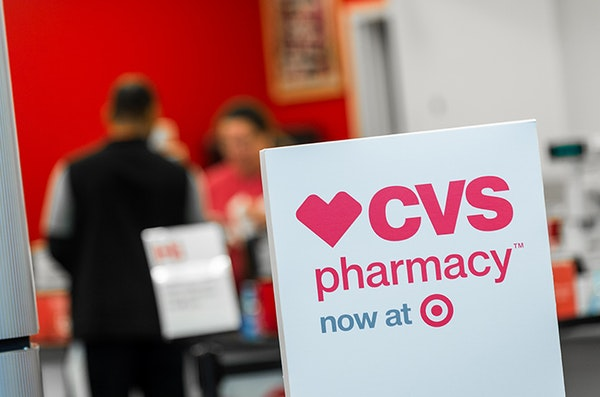 Signs for CVS at a Target story in Charlotte, N.C.