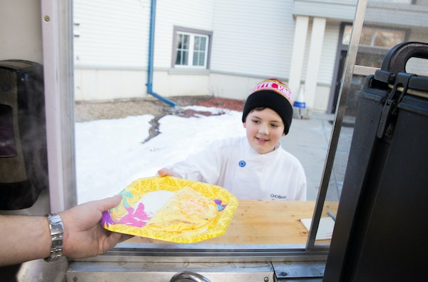 Lucas Hobbs picked up an omelet prepared by Kabomelette to serve to Dakota Woodlands residents on Wednesday.