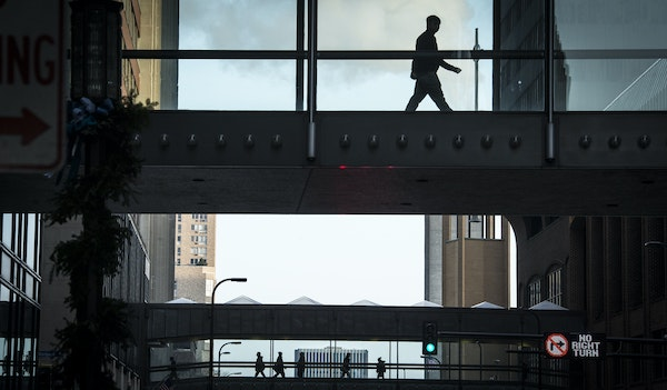 Pedestrians passed over S. 8th Street in downtown Minneapolis. When skyways to the new Wells Fargo buildings and U.S. Bank Stadium open, the system wi