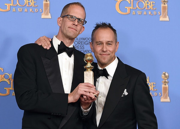 """Pete Docter, left, and Jonas Rivera pose in the press room with the award for best motion picture - animated for """"Inside Out"""" at the 73rd annual Golde"""