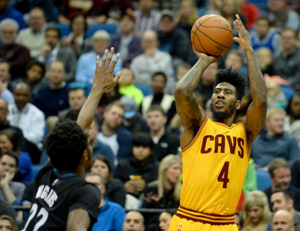 Cavaliers guard Iman Shumpert (4) hit a 3-point shot over Timberwolves guard Andrew Wiggins (22) in the third quarter Friday night.