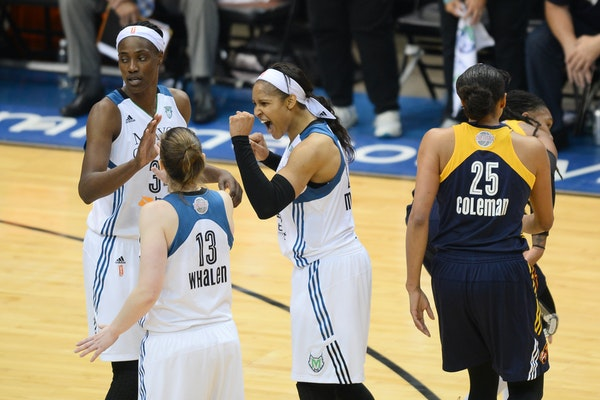 Lynx forward Maya Moore (23) celebrated with guard Lindsay Whalen (13) and center Sylvia Fowles (34) during the WNBA Finals in October.