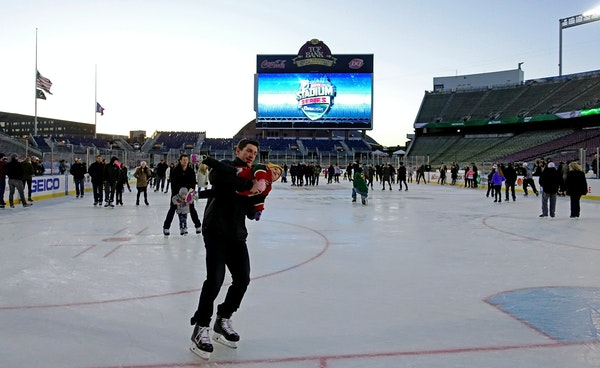 Wild employees, coaches and players were invited to skate with their families Friday night at TCF Bank Stadium. About 100 people were on the ice, whic