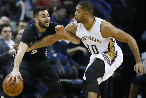 Minnesota Timberwolves guard Ricky Rubio (9) drives against New Orleans Pelicans guard Eric Gordon during the second half of an NBA basketball game Tu