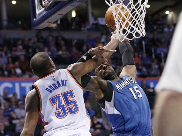 Minnesota Timberwolves forward Shabazz Muhammad (15) is fouled by Oklahoma City Thunder forward Kevin Durant (35) as he shoots during the second quart