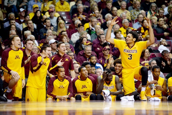 Players on the Minnesota Golden Gophers bench, including forward Jordan Murphy (3), erupted after a shot made by guard Kevin Dorsey (4) in the first h