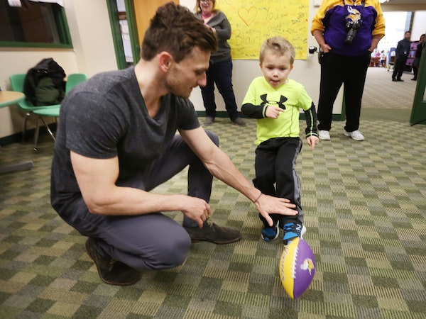 Minnesota Vikings kicker Blair Walsh held a football for Max Birdwell during a visit at Northpoint Elementary School on Thursday.