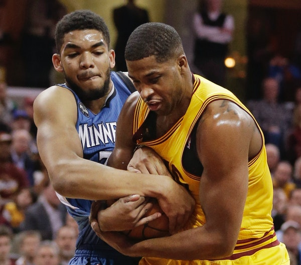 Timberwolves center Karl-Anthony Towns, left, and Cleveland's Tristan Thompson battled for the ball in the first half Monday night.