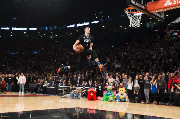 Minnesota Timberwolves' Zach LaVine slam dunks the ball during the NBA all-star skills competition in Toronto on Saturday, Feb. 13, 2016. (Mark Blinch