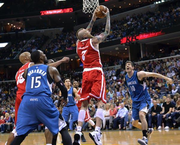 Memphis Grizzlies center Chris Andersen (7) shoots between Minnesota Timberwolves forwards Shabazz Muhammad (15) and forward Damjan Rudez (10) during