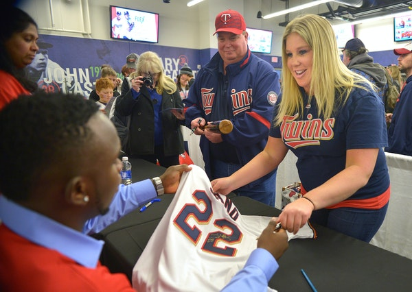 Miguel Sano signs a replica jersey for Chelsea Beaver, 29 and her dad Randy Beaver, of Verndale, MN Saturday, January 30 at TwinsFest at Target Field.