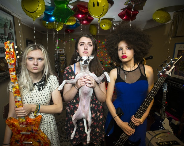 From left, Emily Schoonover, Danielle Cusack (with Schoonovers dog Eugene) and Bella Dawson of Bruise Violet, who play First Ave this weekend and next