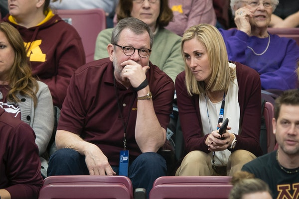 University of Minnesota President Eric Kaler and interim athletic director Beth Goetz had a conversation in the stands prior to Friday night's NCAA to