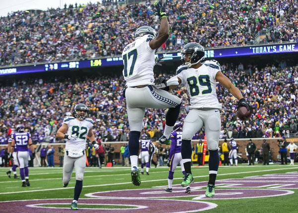Seattle wide receivers Kevin Smith (17) and Doug Baldwin romped during one of many end-zone celebrations the Seahawks enjoyed in a 38-7 victory over t