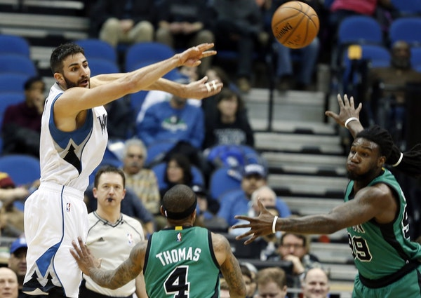 Wolves guard Ricky Rubio passed over the Celtics' Isaiah Thomas (4) as teammate Jae Crowder, right, watched during the first quarter of Minnesota's 12