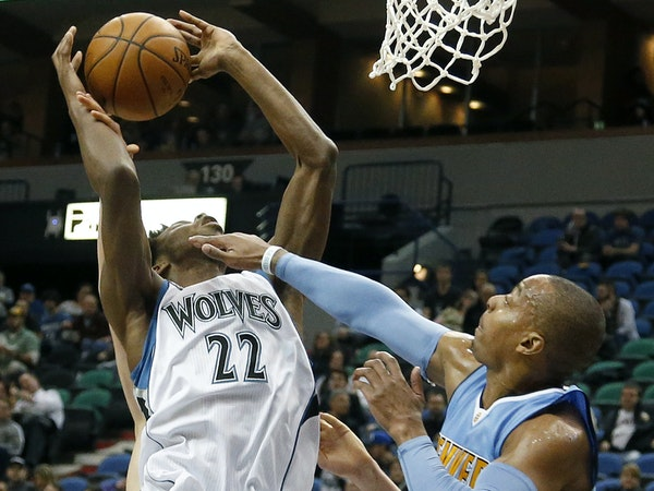 Andrew Wiggins (22) was fouled by Randy Foye (4) in the second quarter.