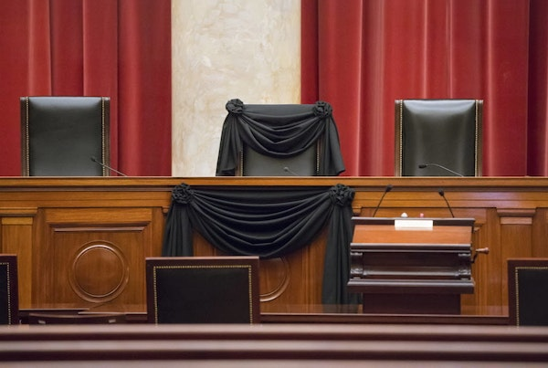 Supreme Court Justice Antonin Scalia's courtroom chair was draped in black Tuesday to mark his death at the Supreme Court in Washington.