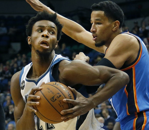 The Wolves' Andrew Wiggins, left, was defended by Oklahoma City's Andre Roberson in the first quarter Tuesday.