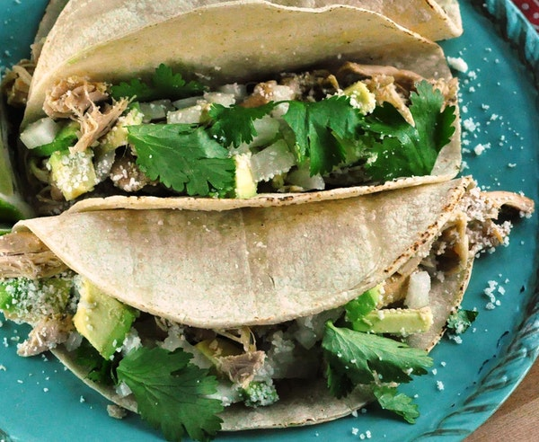 Slow Cooker Green Chile Chicken Tacos.