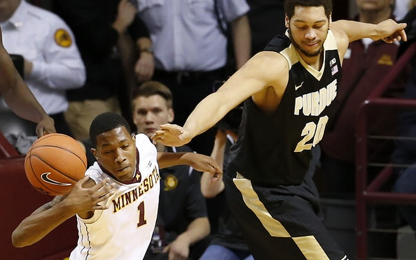 Dupree McBrayer (1) stole the ball from A.J. Hammons (20) in the first half.