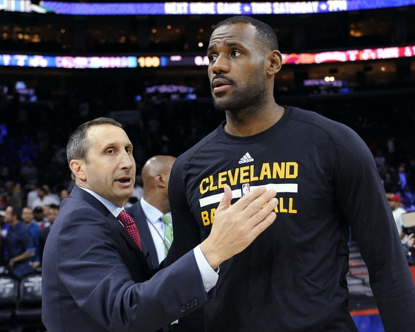 FILE - In this Nov. 2, 2015, file photo, Cleveland Cavaliers coach David Blatt pats LeBron James on the chest at the end of a game against the Philade