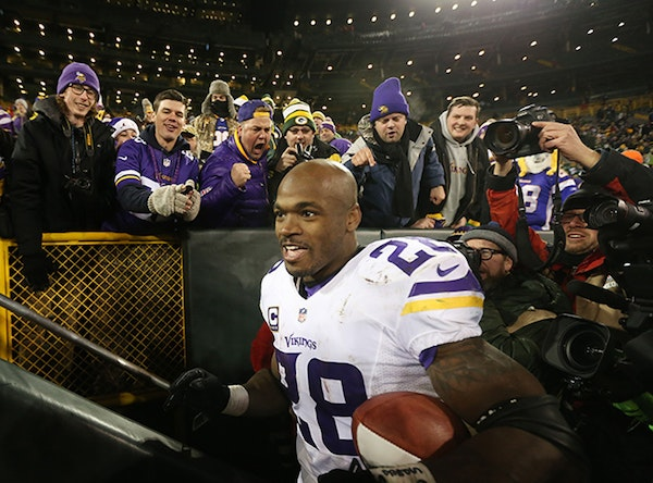 Minnesota Vikings running back Adrian Peterson (28) celebrated with fans after the win Sunday January 3, 2016 in Green Bay, Wisconsin.