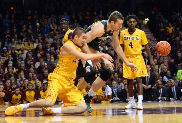 Gophers forward Joey King, left, still leads the team in scoring with 12.8 points a game, but he has been in a shooting slump.