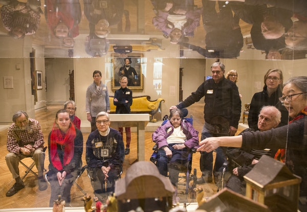 Grace Goggin, right, a docent at the Minneapolis Institute of Art, used objects from the museum's collection to help adults with memory loss and their