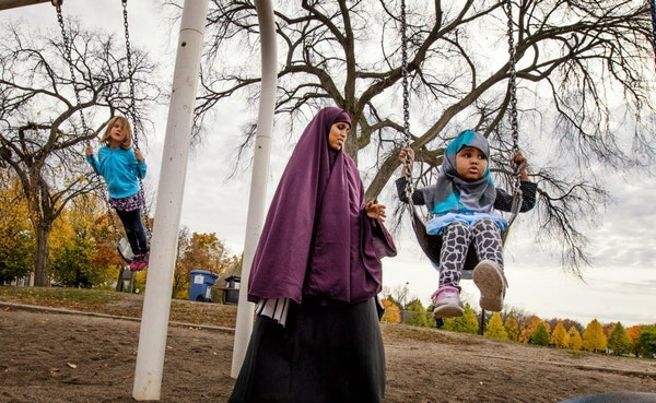 Faisa Adeys pushed her 2-year-old daughter Mumtaz in a swing in Matthews Park, Minneapolis. Minneapolis park leaders formally proposed that all city r