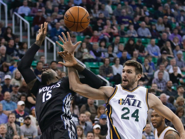 Minnesota Timberwolves forward Shabazz Muhammad (15) and Utah Jazz center Jeff Withey (24) compete for a rebound during the second quarter of an NBA b