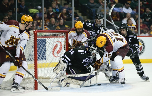 Gophers forward A.J. Michaelson (15) tried to get to the loose puck in front of Minnesota State Mankato goalie Cole Huggins (34) in the second period