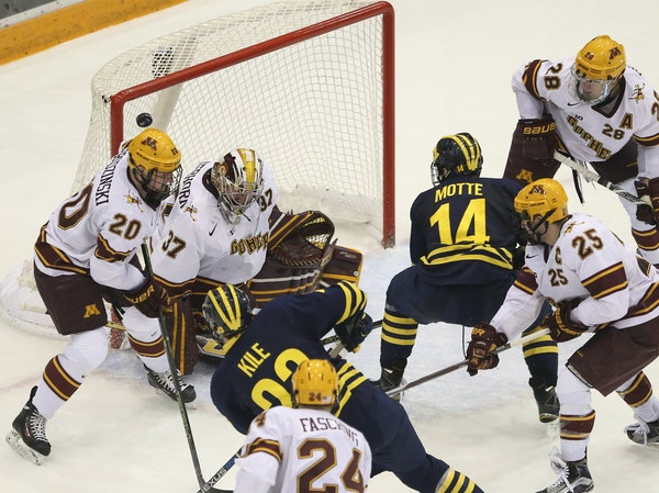 Wolverines forward Alex Kile scored his second goal of the game in the second period, beating Gophers goalie Eric Schierhorn. He finished with a hat t