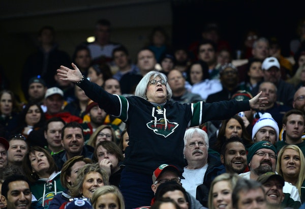 A Minnesota Wild fan calls for the firing of head coach Mike Yeo late in the third period of a 4-2 loss against the Boston Bruins at Xcel Energy Cente