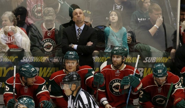 Wild coach Mike Yeo checked the scoreboard during the third period of Saturday's 4-2 loss to the Boston Bruins at Xcel Energy Center. Time was running