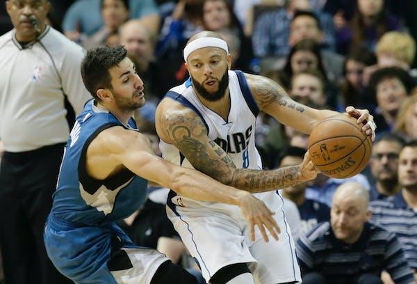 Minnesota Timberwolves guard Ricky Rubio (9) reaches in against Dallas Mavericks guard Deron Williams (8) during the first half of an NBA basketball g