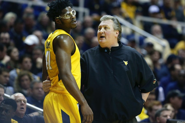 West Virginia coach Bob Huggins talked to forward Devin Williams earlier this month. The Mountaineers share the Big 12 lead with Kansas and Oklahoma.