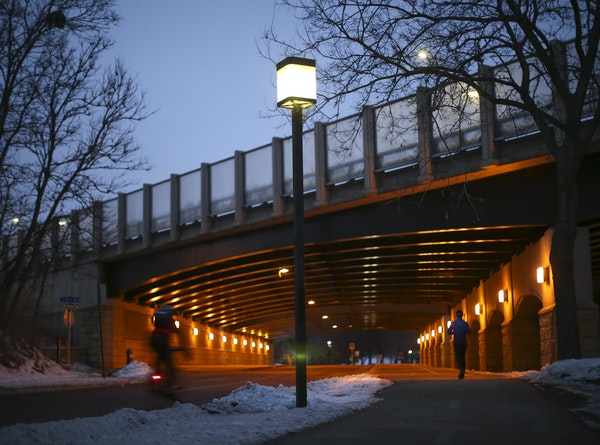 A streetlight on Minnehaha Parkway near an I-35W overpass earlier this month. LED lights can be seen illuminating the freeway.