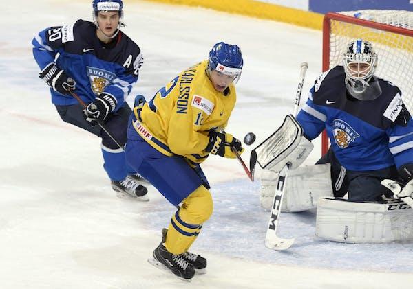 Finnish goalie Kaapo Kahkonen, a Wild draft pick, kept on eye on the puck and Sweden's Jakob Forsbacka Karlsson during Monday's world juniors semi